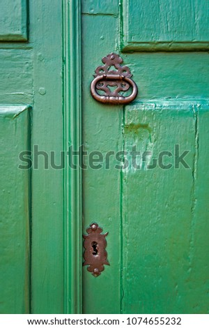 Ancient colonial door detail, Tiradentes, Minas Gerais, Brazil #1074655232