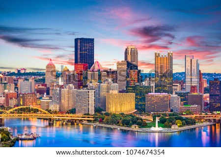 Pittsburgh, Pennsylvania, USA downtown city skyline on the rivers at dusk.