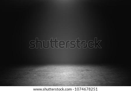 cement floor in the dark background. #1074678251