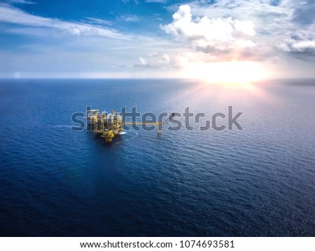 Aerial view industrial offshore oil and rig drilling platform in the gulf with blue sky,Copy space. #1074693581