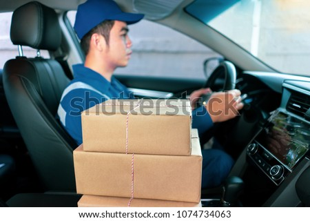 The delivery driver Man driving van with parcels box on seat outside the warehouse, cargo truck delivering a package for the customer, shopping online Entrepreneur  for a small startup business #1074734063