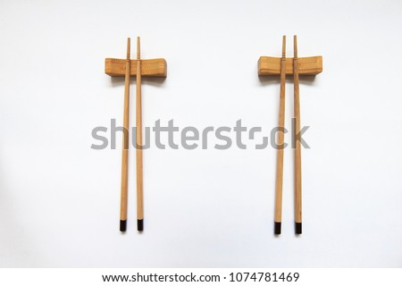 Wooden pairs of chopsticks on white background. space for text, image, advertisement. cooking culture in Asian countries. #1074781469