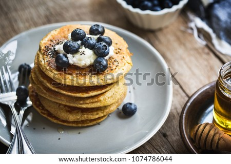 Banana Oat Pancakes with Blueberries, Coconut cream and Chia top Royalty-Free Stock Photo #1074786044