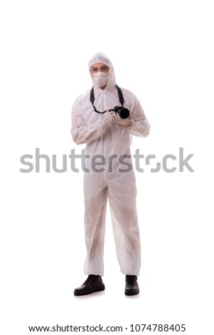 Forensic specialist in protective suit taking photos on white #1074788405