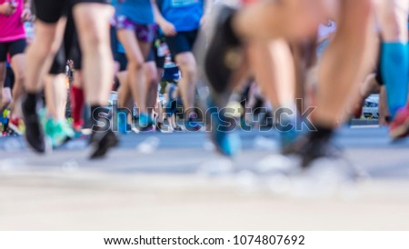 marathon runners in the city  #1074807692