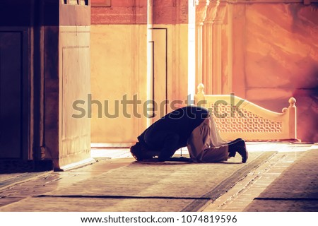 The muslim prayer for god in the mosque. Old iranian Muslim is on his knees praying. Holy month of Ramadan Muslims. Moslem, mohammedan, muslimah. monk, friar, monastic, Royalty-Free Stock Photo #1074819596