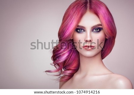 Beauty Fashion Model Girl with Colorful Dyed Hair. Girl with perfect Makeup and Hairstyle. Model with perfect Healthy Dyed Hair. Rainbow Hairstyles #1074914216
