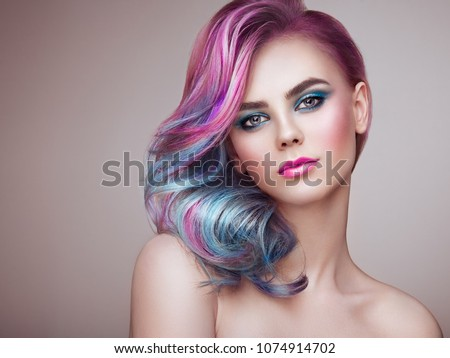 Beauty Fashion Model Girl with Colorful Dyed Hair. Girl with perfect Makeup and Hairstyle. Model with perfect Healthy Dyed Hair. Rainbow Hairstyles #1074914702