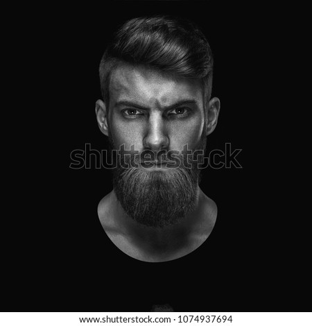 Black and white portrait of serious young man Isolated on black background and looking at camera Confident concept #1074937694