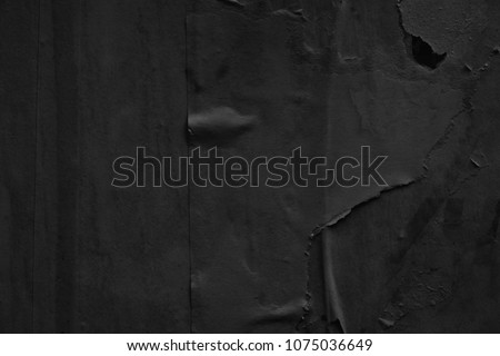 Dark black grey paper background creased crumpled surface / Old torn ripped posters scary grunge textures backdrop  #1075036649