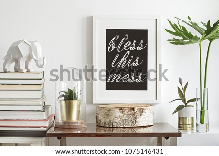 Interior of vintage space with mock up poster frame, plants, tropical leafs books and white elephant figure. Shelfie concept.