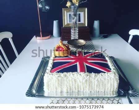 A celebration cake British themed. With the Union Jack as decoration.