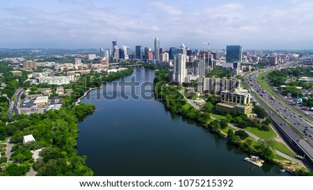 Austin , Texas , USA skyline cityscape downtown entire capital cities view of central Texas city with interstate 35 and Colorado river bend and green summer landscape #1075215392
