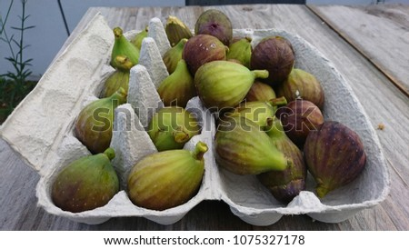 Figs in egg box on a table #1075327178