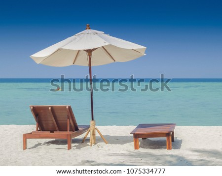 view seaside of white umbrella and beach chair on the white sand beach with blue-green sea and blue sky background, andaman beach, Ko Lipe island, Satun southern Thailand. #1075334777
