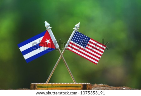 United States of America and Cuba small flag with blur green background #1075353191