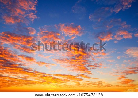 colorful sunrise sky with blue, orange, and yellow color.  #1075478138