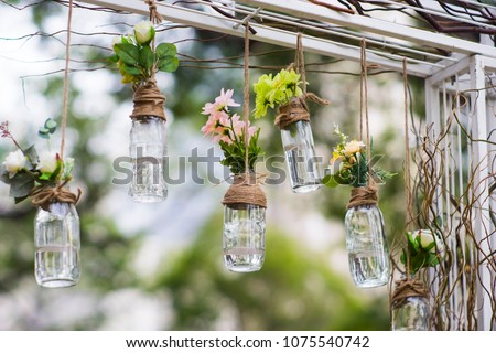 DIY old empty bottles can be used for event decoration as a flowers vases hand from bars Royalty-Free Stock Photo #1075540742