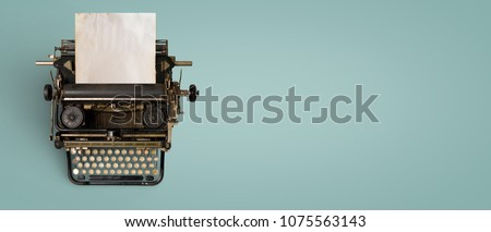 Vintage typewriter header with old paper. retro machine technology - top view and creative flat lay design.  #1075563143