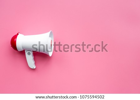 Attract attention concept. Megaphone on pink background top view copy space #1075594502