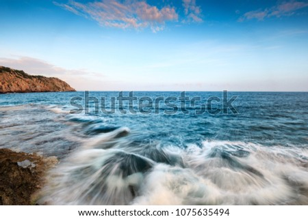 Vinh Hy beach in the afternoon. Vinh Hy is located in Vinh Hai Commune, Ninh Hai District, Ninh Thuan Province, Vinh Hy is located between three wild mountains, in front of the vast blue ocean #1075635494