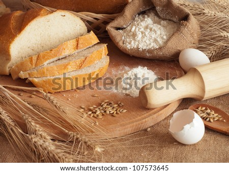 fresh bread and wheat spikelets #107573645