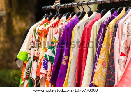 Sale of colorful kimonos on the city street in Kyoto, Japan. Close-up Royalty-Free Stock Photo #1075770800