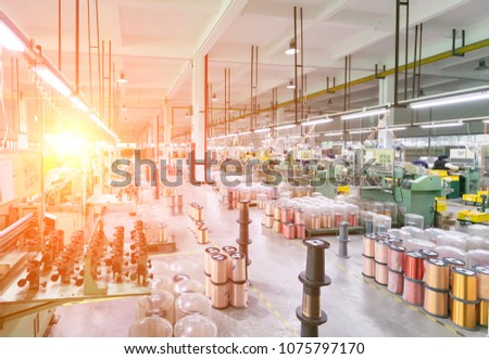 Modern industrial background:factory workshop interior,machines and industrial products #1075797170
