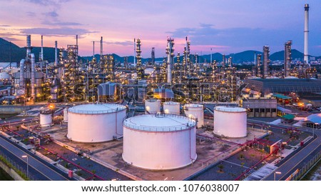 Oil refinery plant from industry zone, Aerial view oil and gas petrochemical industrial, Refinery factory oil storage tank and pipeline steel at night, Ecosystem and healthy environment concepts. #1076038007