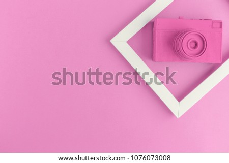 Retro film photo camera colored in pastel pink with photo frame minimal abstract creative concept. Space for copy. #1076073008
