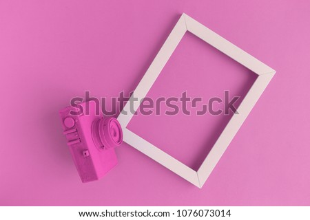 Retro film photo camera colored in pastel pink with photo frame minimal abstract creative concept. Place for photo adding. #1076073014