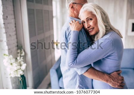 The happy elderly man and a woman hugging #1076077304
