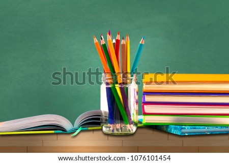 Books ,pen,pencil,Scissors and office equipment on green background, education and back to school concept,Clipping path #1076101454