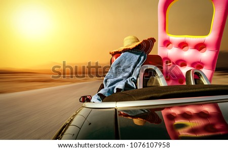 Summer car and road with sunset of golden colors. Free space for your text.  #1076107958