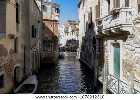 Venice canal with boats and typical buildings,Italy, 2017. #1076212310
