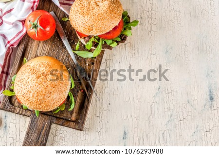 Homemade bbq beef meat sandwich burger with fresh vegetables copy space above #1076293988