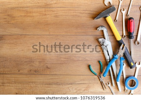 A lot of wrenches. The working set of wrenches on wooden background. Tooling. #1076319536