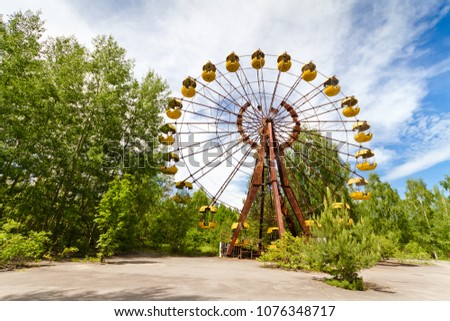 The abandoned Ferris wheel in the amusement park in a dead city Pripyat, Ukraine. Chernobyl nuclear power plant zone of alienation #1076348717