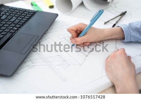 Architect at work, close-up hands with a pencil in front of the laptop. #1076517428