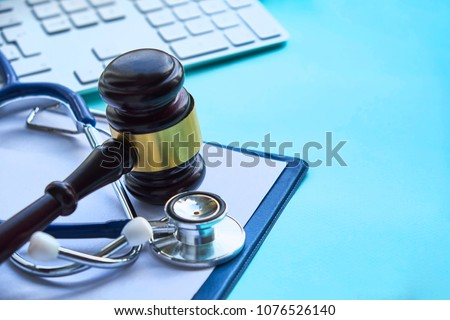 Gavel and stethoscope. medical jurisprudence. legal definition of medical malpractice. attorney. common errors doctors, nurses and hospitals make. #1076526140