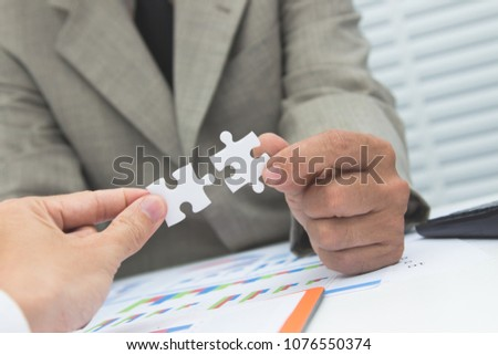 Businessmen hand are invstment project rsidence at work office.Concept Business. #1076550374