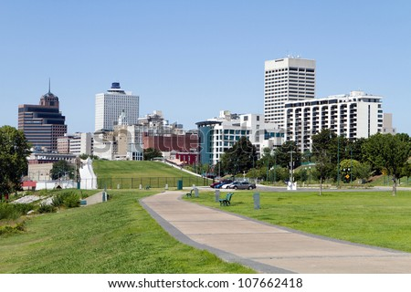 View of the Memphis, Tennessee city skyline from a park in the downtown area.