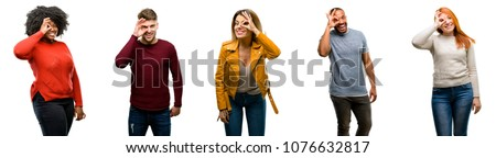 Group of cool people, woman and man looking at camera through fingers in ok gesture. Imitating binoculars, beautiful eyes and smile #1076632817