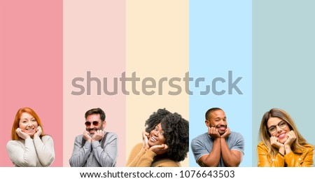 Cool group of people, woman and man happy and surprised cheering expressing wow gesture #1076643503