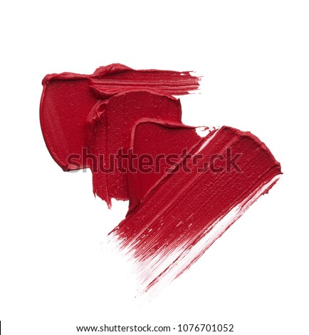 Red makeup smear of matte lip gloss isolated on white background. Red creamy lipstick texture isolated on white background #1076701052