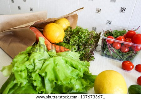 vegetables on the kitchen table in a paper bag, shopping for a diet and proper nutrition. ecology #1076733671