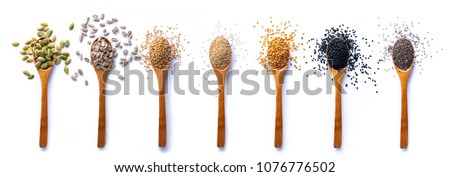Flat lay of arranged wooden spoons with various healthy seeds in mix on white background. #1076776502