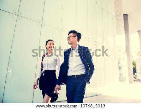 Asian business people discussing while walking #1076815013