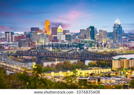 Cincinnati, Ohio, USA skyline on the river at dusk.