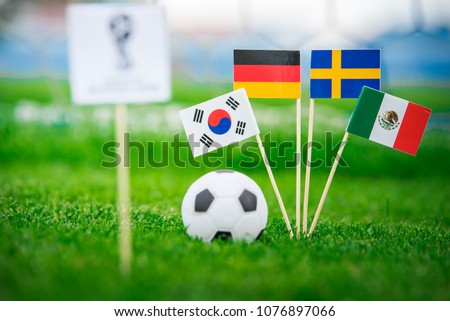 MOSCOW, RUSSIA - APRIL, 24, 2018: Group F - National flags of Germany, Mexico, Sweden, Korea Republic, South Korea and Official logo of FIFA World Cup 2018 in Russia. White background, edit space. #1076897066